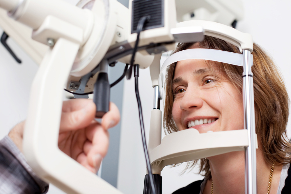 woman receiving an eye exam from her local optometrist